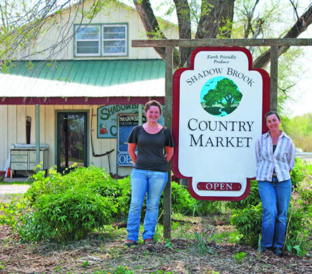 Charuth and Allie Plettner outside the on-farm Country Market, where you can purchase Dutch Girl Creamery cheeses. Photo by Sarah Kay Bryan