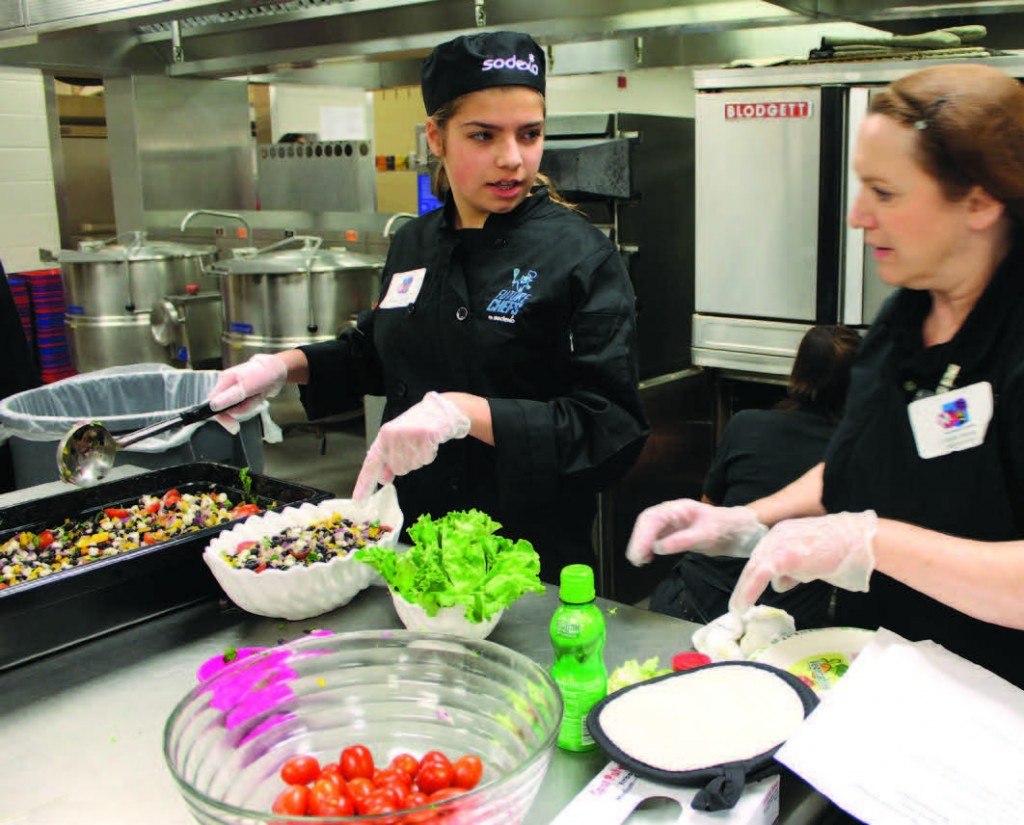 Kacie Shields puts the finishing touches on her Mexican Black Bean and Hominy Salad, a recipe inspired by her father.