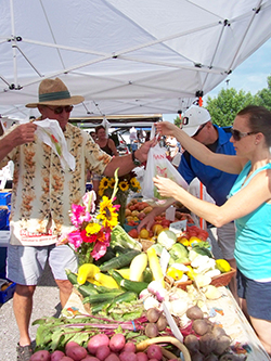 Sundays in Valley (Nebraska), local artisans set up downtown to support the community. Lisa McCloskey of School House Gardens greets residents by first name.