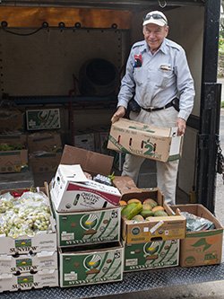 David Hibler (Dr. D), Community Produce Rescue of Benson coordinator, picks up salvageable fruit and vegetables from Whole Foods Market to distribute to food pantries, homeless shelters and other locations for those in need.