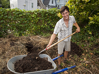 Matt Cronin of Big Muddy Farm shovels compost. The farm collects pre-consumer food waste for its compost piles.