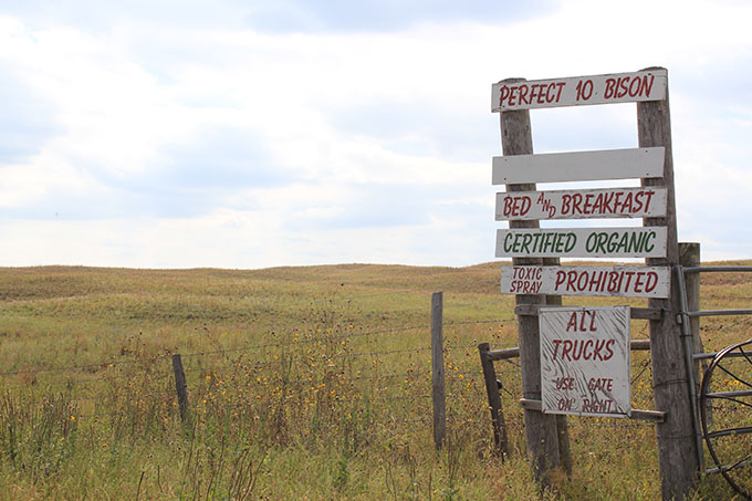 This sign of many signs greets those visiting Perfect 10 Bison and Hutchinson Organic Ranch near Rose, Nebraska.
