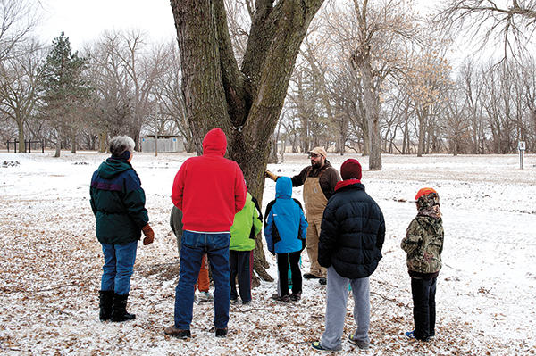 on Fenner, in his 16th year of collecting sap, explains the process during the annual maple tree tapping at Botna Bend, an event open to the public.