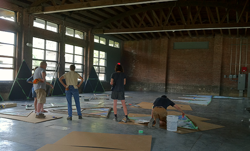 The participant volunteers from the community spent weekends collaborating with artist Mary Mattingly at the Bemis Center for Contemporary Art on the design and building of two Flock Houses.