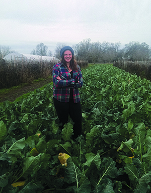 Standing in a broccoli field, Terra Ash Bruxvoort is continuing her farming education this winter at a farm in Vina, California.