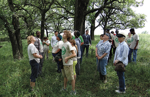 olunteers with Omaha's City Sprouts and the Heartland Trailblazers visit the oak savanna where some day in the near future, free-range hogs might be fattening up on fallen acorns. Photo by Clair Celsi