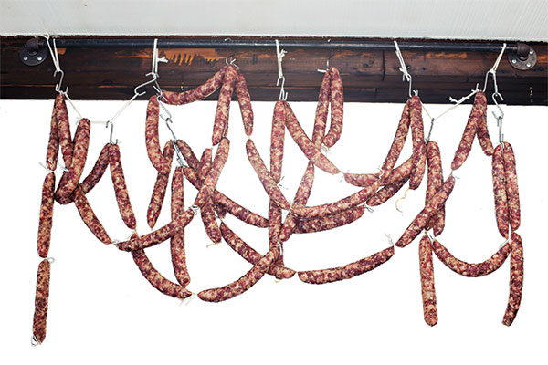 Tuscan salamis hang from the ceiling of the shop, located off of the main street in Ft. Calhoun. The aroma of meats curing with various herbs and spices fills the 400-square-foot building.