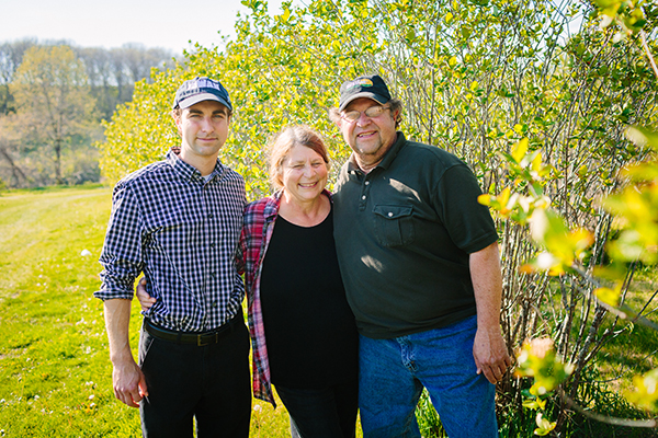 """Andrew Pittz (left), who has adopted the title """"farmer in chief"""" at Sawmill Hollow is shown here with his parents, Cindy and Vaughn Pittz. His desire is """"to share the stories of as many great people"""" working in local agriculture as he can."""
