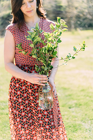 Heather Smith, general manager and certified sommelier at the Grey Plume assists with bouquets of aronia berry branches for the dinner table.