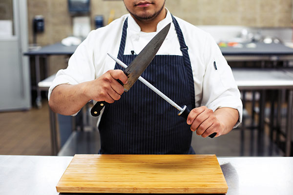 Student Danny Flores demonstrates common cuts.
